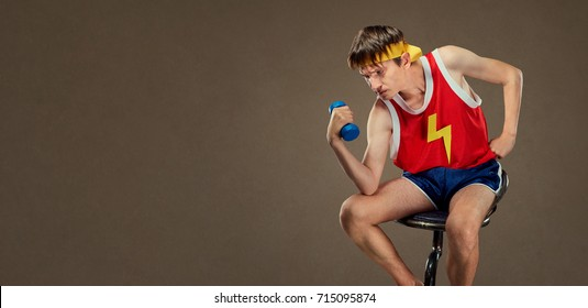 A thin funny guy in sports clothes in the pose of the Greek thin