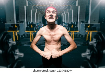Thin guy poses on workout in gym, dystrophic