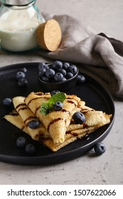 thin pancakes with blueberries for breakfast