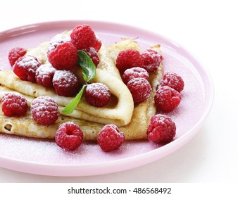 thin pancakes with fresh berries