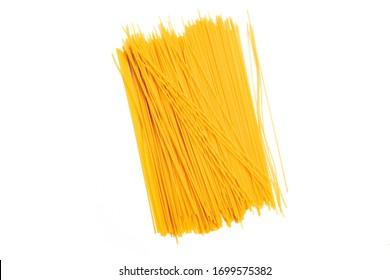 Thin pasta arranged in rows. Yellow italian pasta. Long spaghetti. Raw spaghetti wallpaper. Food background concept.