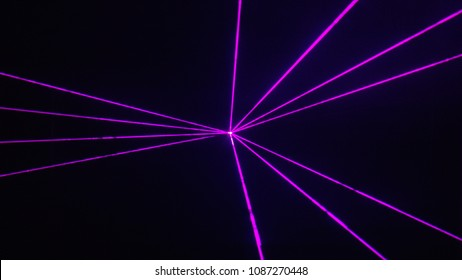 Thin purple laser light beams, grouped into sections, make a cool pattern over black. Great graphic for music / EDM vibe.