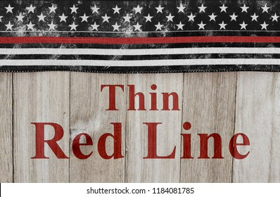 Thin Red Line text with USA patriotic old thin red line flag on a weathered wood