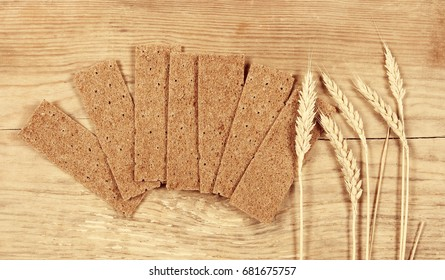 Thin rye breads lie on a wooden table