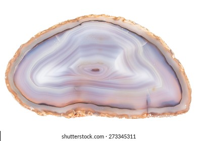 Thin slice of agate geodes with concentric layers isolated over a white background