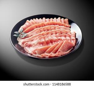 Thin sliced pork on white plate