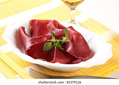 Thin slices of dry cured ham in a bowl