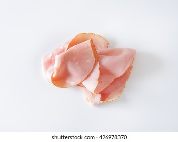thin slices of ham on white background