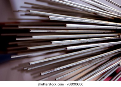 thin steel reinforcement bar close up end view metal background