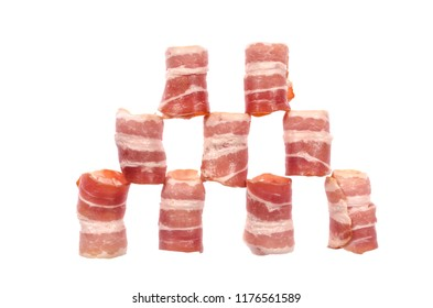 Thin strips of smoked bacon lined in a shape isolated on a white background.