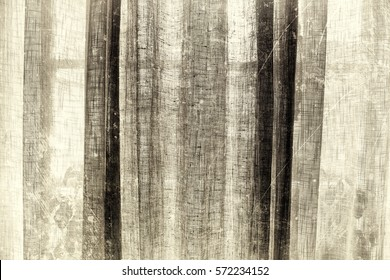 Thin transparent linen curtain textured in sepia tones with scratches and stains for an old fashion style as background with copy space.