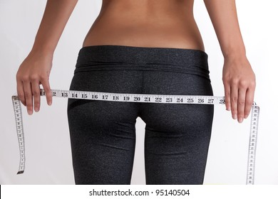 Thin Woman measuring butt and hips