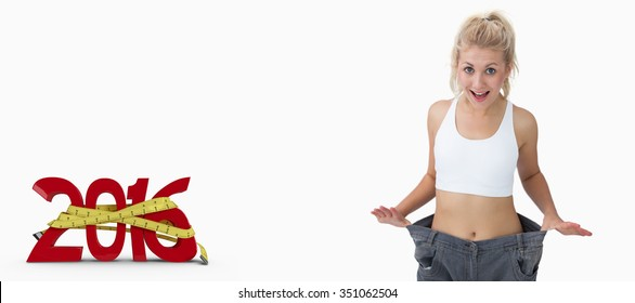 Thin woman wearing old pants after losing weight against white background with vignette