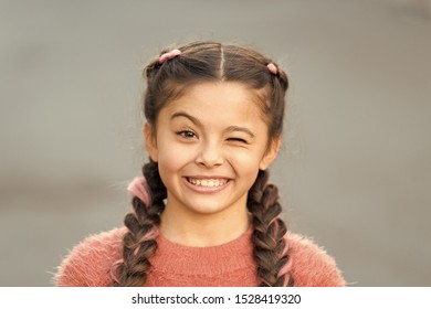 Things gonna be alright. Girl wink cheerful face grey background. Kid girl cheerful satisfied with everything. Cheerful mood positive emotions. Pretend and joking. Playful child cheerful expression.