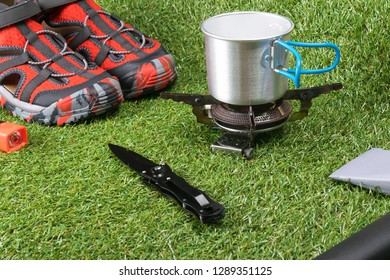 things for hiking and recreation tourist in extreme conditions lie on the green grass