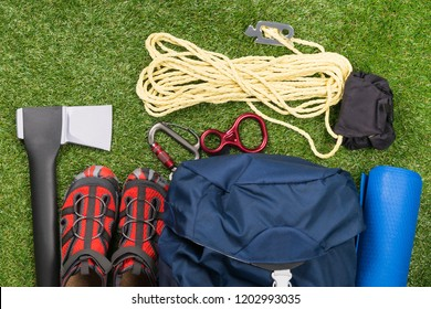 things for a long hike in the forest and survival in it, set on a green lawn