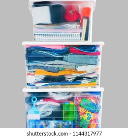 Things packed plastic container boxes tower Moving house concept Order storage Copy space isolated Grey background