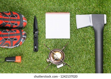 things for the tourist and notebook lie on the green grass