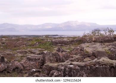 Thingvellir, Iceland. Lake and rocks and mountain landscape