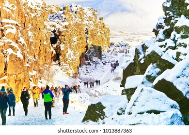 Thingvellir National Park, Iceland - January 28, 2017: View of the canyon at the Thingvellir National Park with lots of tourists in Iceland in winter on January 28, 2017.