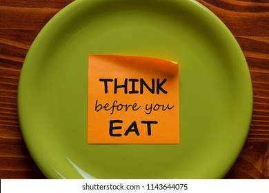 Think Before You Eat written on sticky note on the green plate. Health Tip.