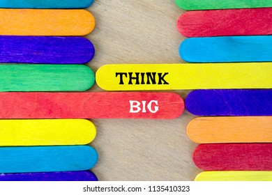 Think big quote on colorful wooden stick - business conceptual