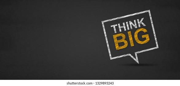 Think big and speech bubble on a blackboard.