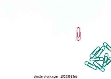 Think different concept for group of stacked paperclip with another one Red paper clip is point to another direction as a team leadership, Business and finance
