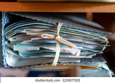 Think dossier folder with tons of papers and documents, top secret or reserved information in a office cabinet