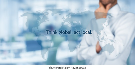 Think global, act local. Globalization business rule. Businessman think about this rule. Wide banner composition, office in background.