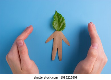 Think green concept. paper person with green leaf on the head