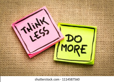 think less, do more reminder - inspirational handwriting on sticky notes against burlap canvas