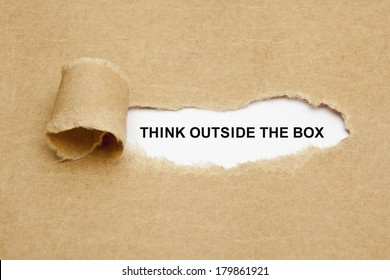 Think Outside The Box appearing behind torn brown paper.