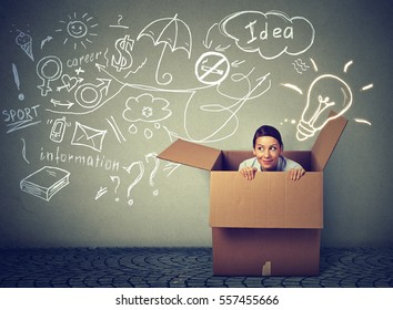 Think outside the box concept. Young woman coming out of box isolated on info graphic gray wall background