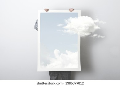 think outside the box, surreal concept of a clouds getting out of a poster