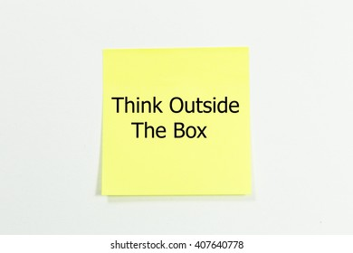 think outside the box word written on yellow sticky notes.