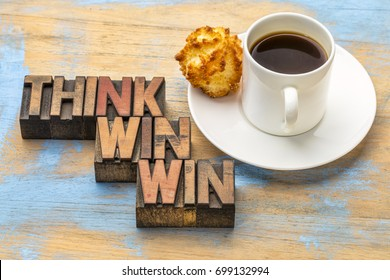 think win-win - word abstract in vintage letterpress wood type blocks against grunge wooden background with a cup of coffee