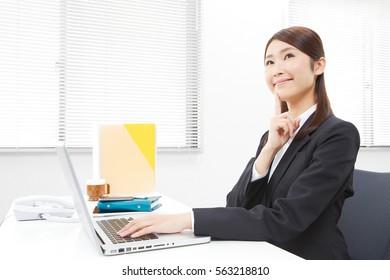 thinking Asian businesswoman