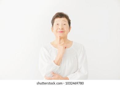 thinking Asian woman