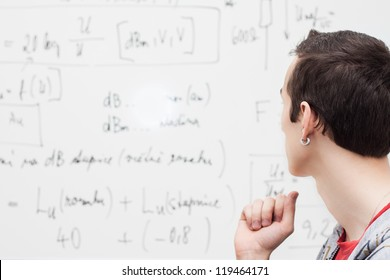 Thinking boy with whiteboard solving equation