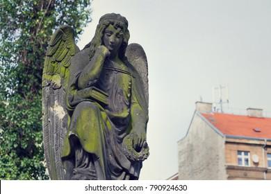 Thinking broody angel statue on Malostransky cemetery, Prague, Czech Republic