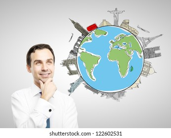 thinking businesman with drawing colorized earth, traveling concept