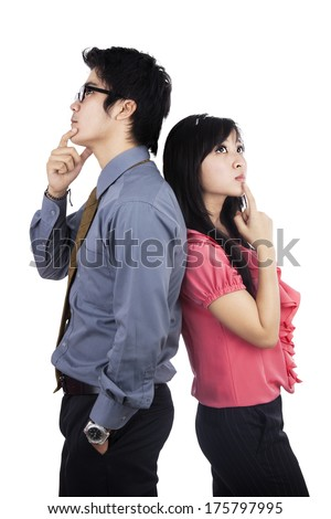 Thinking Business Partners Backtoback Against White Stock Photo