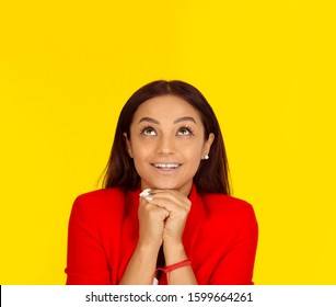 Thinking business woman looking up smiling happy. Mixed race model isolated on yellow background with copy space. Horizontal image. - Shutterstock ID 1599664261