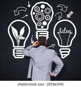 Thinking businessman against blackboard