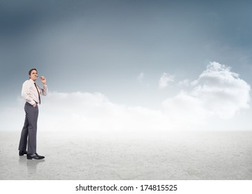 Thinking businessman holding glasses against cloudy sky background