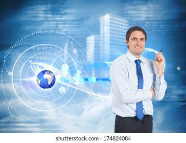 Thinking businessman holding pen against holographic cityscape in clouds, elements of this image furnished by NASA