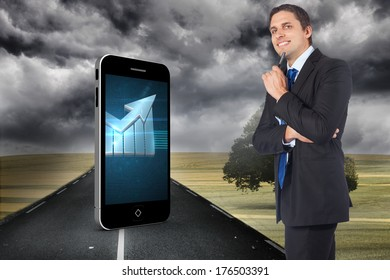 Thinking businessman holding pen against misty green landscape with street