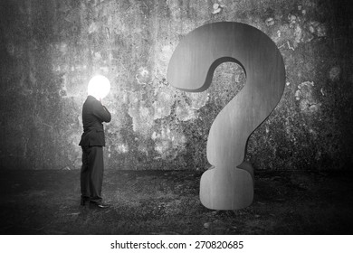 Thinking businessman with lamp head illuminated 3d concrete question mark and dark mottled wall background