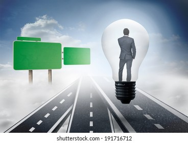 Thinking businessman in light bulb against roads over clouds with empty signposts